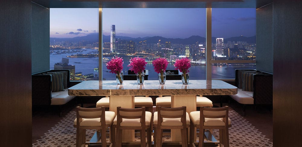 Executive Lounge at Conrad Hong Kong and Hong Kong's skyline, as seen from the Executive Peak View Suite Living Room